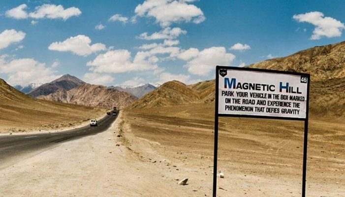 Picture Of Magnetic Hill Road And A Signboard | Magnetic Hill India - Hikerwolf